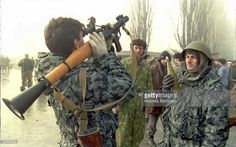 Chechen soldiers prepare an anti-tank grenade as they hold positions on the road awaiting Russian troops who are reportedly some 40 kilometers (32 miles) west of Grozny 15 December 1994.The Red Cross is sending extra emergency medical supplies to Chechnya as hopes for an early peace settlement faded.