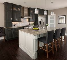 kitchen design ideas black cabinets white kitchen island Santa Cecilia granite countertop hardwood floor