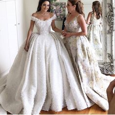 This traditional style ball gown wedding dress is full of bling.  Custom off the shoulder #weddingdresses can be made in an affordable price range by us.  We also make #replicas of couture designer #dresses for brides who can not afford the original but still want the same overall look.  Email us for pricing.  DariusCordell.com