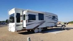 """2010 Used Carriage Cameo F36FWS Fifth Wheel in Arizona AZ.Recreational Vehicle, rv, Bigfoot auto-level, Three zone halogen lighting, Carefree electric awnings (2), Frameless dual pane windows, Corian counter tops, Stainless under-mounted kitchen sink, Cherry hardwood cabinets, Central Vac, Fantastic vent fan, Kitchen island, 2nd A/C, Mor/Ryde pinbox, 22"""" LCD bedroom TV, King latex bed, Samsung 37"""" LCD surround system, Wineguard satellite dish, Generator prep, surge protector, Convection MW…"""
