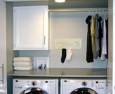 We finally put the finishing touches on our laundry closet!         You might remember what the area looked like before we even started...