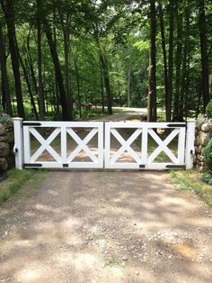 Wood Cross-buck Post and Rail Automated Entry Gate. Simple but it will work.