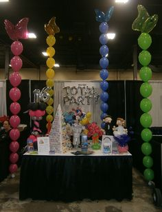 These butterfly balloon columns were 15 feet tall and seen across the convention center.  www.Total-Party.com   We can create these in a variety of colors with many different toppers to match your theme.