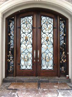 Pretty wrought iron front door