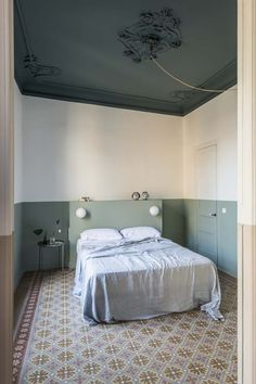 After a fire tragically wreaked severe damage to the interior, CaSA refurbished the Klinker family apartment in Barcelona with clever use of materials. Family Apartment, Apartment Design, Home Interior, Interior Architecture, Interior Design, Bedroom Ceiling, Bedroom Decor, Casa Milano, Mint Walls