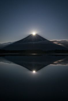 """nxtureporn: """" """"In Japan, the moon overlapping with the top of Fuji is called Pearl Fuji (in the case where the sun overlaps with the top of Fuji, the phenomenon is called Diamond Fuji). Pearl Fuji reflected in the water is called Double Pearl. Beautiful Lights, Beautiful Pictures, Mount Fuji Japan, Monte Fuji, Weather Storm, Digital Photography School, Beautiful Places In The World, Belleza Natural, Airplane View"""