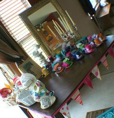 Alice in Wonderland Mad Tea Party Baby Shower - table and tea cup sculptures: Alice in Wonderland Mad Tea Party Baby Shower  The theme was everything Alice, but it had to be mad!    Our shower journey began with the invitations which