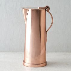 """Serve mimosas at brunch or sangria on the patio with this polished, copper pitcher.- Stainless steel, copper finish- Hand wash- Imported10""""H, 4"""" diameter"""