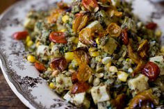 A one-skillet quinoa recipe - quinoa, corn, chopped kale and pan-toasted tofu tossed with a big dollop of pesto and finished off with a few roasted cherry tomatoes.