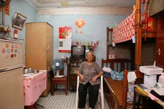 Michael Wolf, 100 x 100 photographs of residents in their flats in hong kong's oldest public housing estate: 100 rooms, each 100 square feet in size.
