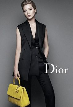 Jennifer Lawrence, poses w/ Be Dior Bag for Miss Dior F/W 2014 ad campaign - her campaign for the Paris label, and wearing pantsuits designed by Raf Simons Miss Dior, Jennifer Lawrence Dior, Christian Dior, Dior Handbags, Dior Bags, Michelle Williams, Holiday Fashion, Women's Fashion, French Fashion