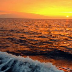 Sunrise while deep-sea fishing  Over Maui, Hawaii