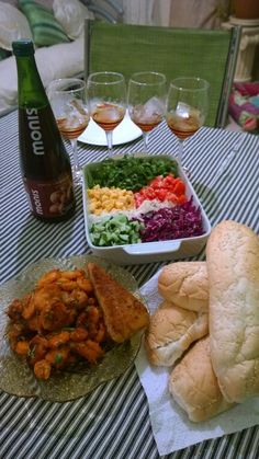 Salad with grilled prawns and fish with grape juice and bread