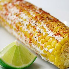 Mexican Grilled Corn - its actually really good!    6 ears corn, husked      1 teaspoon chili powder      1/2 teaspoon salt      1/8  teaspoon freshly ground black pepper      Cooking spray      1/4 cup crema Mexicana (can be replaced with low-fat or regular sour cream)      6  lime wedges