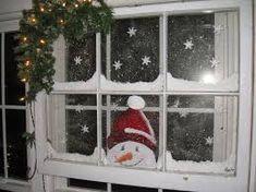 Resultado de imagen de ventanas decoradas de navidad con nieve
