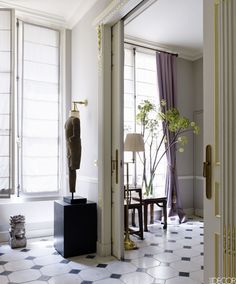 In his new Paris apartment, designer Christopher Noto gives free rein to his love of Asian furniture, artifacts, and handicrafts, without for a moment shortchanging classic French style. ​​