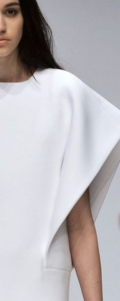 Detail of a dress by fashion designer Tze Goh. Sculptural and minimal. Nice.
