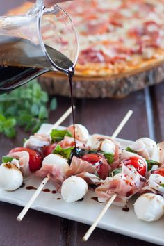 Italian Salad Skewers with Balsamic Glaze - http://www.sofabfood.com/italian-salad-skewers-with-balsamic-glaze/  Fresh mozzarella, prosciutto, cherry tomatoes, and fresh basil are loaded onto a skewer and drizzled with homemade Balsamic Glaze for a party appetizer that's visually appealing and delightful to the taste. These Italian Salad Skewers couldn't be easier to make! #NestleHoliday  With ...