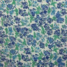 Tissu en coton imprimé fleurs bleu sur fond blanc