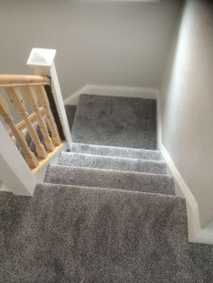 Dark grey stairs carpet supplied and fitted by Out & About Carpets in Stockport