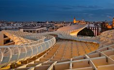 Metropol Parasol by J Mayer H, Seville. The top of the Metropol Parasol incorporates a walkway, offering views across the city. Photograph by Fernando Alda Architecture Wallpaper, Interior Architecture, Wallpaper Magazine, Light And Space, Seville, Building Design, Walkway, City, News Breaking