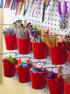 pegboard buckets.... Hang pegboard up and buy little buckets from the dollar store! This would be awesome for markers, paintbrushes, pencils (regular and colored) Love this!