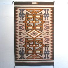 """Tees Nos Pos Weaving with a Pumpkin Squash-Colored Central Panel and Eight Feathers by Emily Malone. $2700  3' Width, 4' 11"""" Height"""