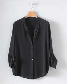 Silk Shirt by Poetry Style with a pair of dark wash jeans & boots