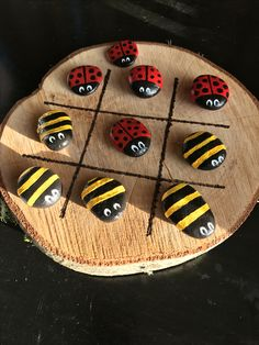 "Handmade ""Bugs & Bees"" Tic Tac Toe board from rocks and a slice of Alder wood. Game anyone?"