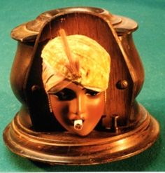 Flapper Cigarette Dispenser: Circa 1930's. Press the button and the lovely lady spits out a cig.