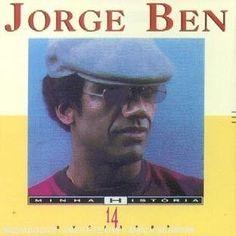 """Serie Minha Historia - 14 Sucessos est une « petite » (14 titres) compilation de Jorge Ben Jor qui date de 1993 avec quelques uns de ses principaux standards. En ouverture le """"somptueux"""" triptyque musical """"Taj Mahal / Filho Maravilha / País Tropical""""...."""