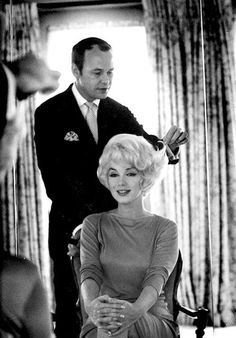 """Here, in 1961 stylist Kenneth """"Mr. Kenneth"""" Battelle is doing Marilyn Monroe's hair. He became her hairdresser in 1958 and remained her go-to stylist when she was in New York until her death."""