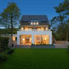Habitações translation missing: pt.style.habitações.moderno por Bau-Fritz GmbH & Co. KG
