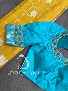 Turquoise blue blouse with yellow saree Cutwork Blouse Designs, Wedding Saree Blouse Designs, Pattu Saree Blouse Designs, Simple Blouse Designs, Stylish Blouse Design, Blouse Patterns, Skirt Patterns, Coat Patterns, Sewing Patterns