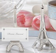 Eiffel Tower Place Card Holders (Set of 4) (Kate Aspen 11063NA) | Buy at Wedding Favors Unlimited (http://www.weddingfavorsunlimited.com/eiffel_tower_place_card_holders.html).