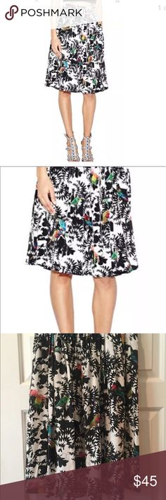 Nicole Miller Artelier silk bird skirt Fantastic silk skirt in black and white with pops of colorful birds thru-out. Has pockets and is unlined. Skirt from Nicole miller in size 8. Skirt was worn once so it's in great condition. No trades Nicole Miller Skirts Midi