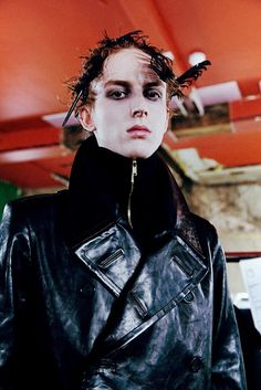A dark swarm of vampires in sweeping villain coats and black feather headdresses at Alexander McQueen AW14: http://www.dazeddigital.com/fashion/article/18335/1/alexander-mcqueen-menswear-aw14