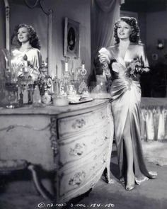 Rita Hayworth 40s evening gown, perfume bottles....Total Glam