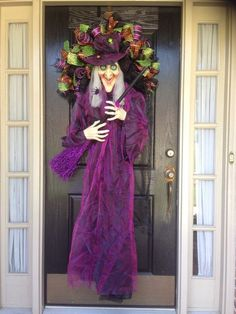 door wreath with a whole witch doll in purple