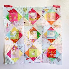Heather Ross - love this simple pattern - exactly the same centers for a Pineapple block beginning!