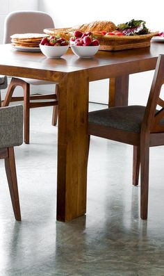 A lovely grained top and well designed legs, the Clarkson dining table is sure to make a bold statement in any home.