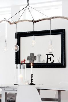 Wooden light fixture...simple and lovely.