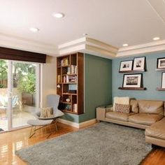teal living room love the color of the walls