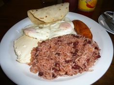 Add these 9 must-try Nicaraguan food and drink items to your travel list! Nicaragua food staples included quesillo, nacatamal, and more (with descriptions). Quesadillas, Nicaraguan Food, Gallo Pinto, American Diet, Frijoles, Caribbean Recipes, Food Staples, Easy Meals, Simple Meals