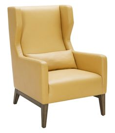 Modern armchair upholstered in leather with walnut legs