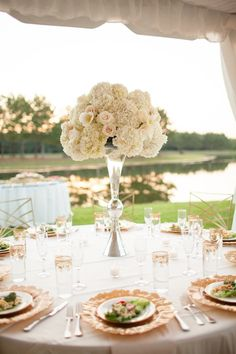 photo: Archetype Studios; Tasteful wedding reception centerpiece idea;