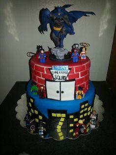 Superhero birthday cake with mini legos figurines and Batman topper