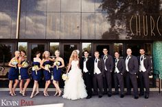 Girls in blue, guys in gray, bride and groom in black and white.