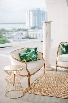 Palm leaf printed pillows and a jute rug: http://www.stylemepretty.com/florida-weddings/miami-beach/2016/06/24/natural-elements-industrial-architecture-combine-for-one-gorgeous-editorial/ | Photography: Katie Lopez - http://katielopezphotography.com/