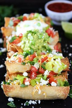 These easy oven Baked Chicken Taquitos are stuffed with chicken and cheese and make a great appetizer or meal. Serve with guacamole, sour cream, and salsa.